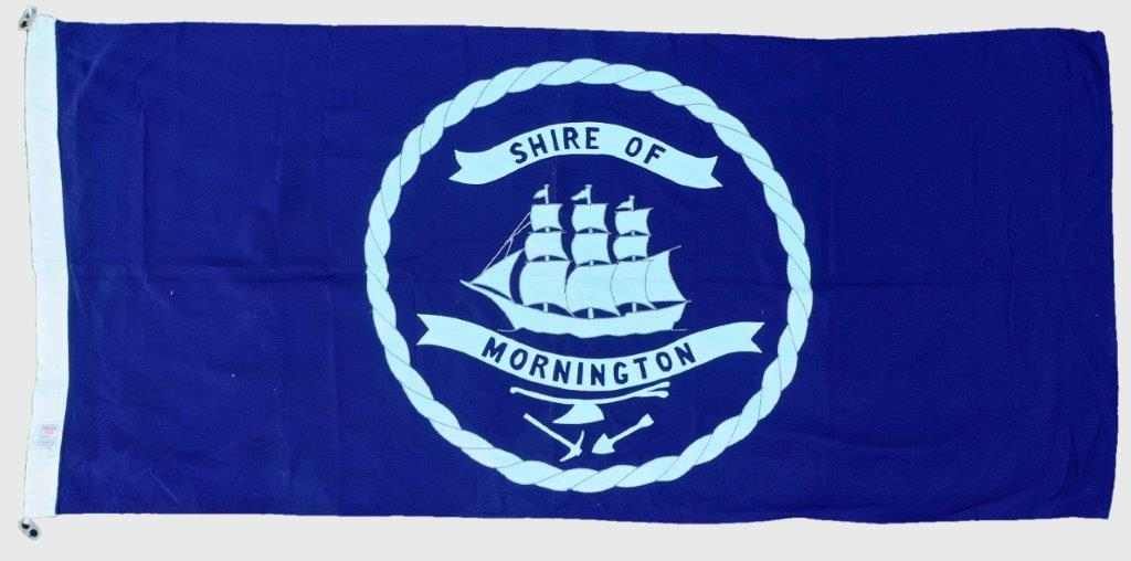 Image of the hand sewn flag of the Shire of Mornington showing a ship logo